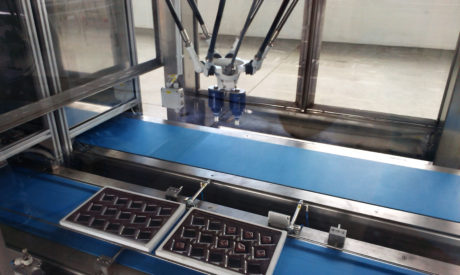 Vuototecnica vacuum cylinders, at work while picking and releasing some chocolates inside their boxes at very high rate.